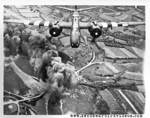 "Photo of an Douglas A-20 Havoc attack bombers wearing ""invasion stripes"" bombing a bridge in Nothern France during the D-Day landings in World War 2."