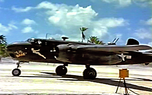"Photo of a 75mm equipped North American B-25G Michell bomber, 48th Bomb Squadron on the Island of Apamama in World War 2 taken from the video ""Winged Artillery."""